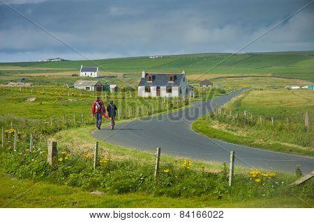 People Walking In Scottish Landscape Orkney Island