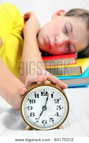 Kid sleep with Alarm Clock on the Bed. Focus on the Clock poster