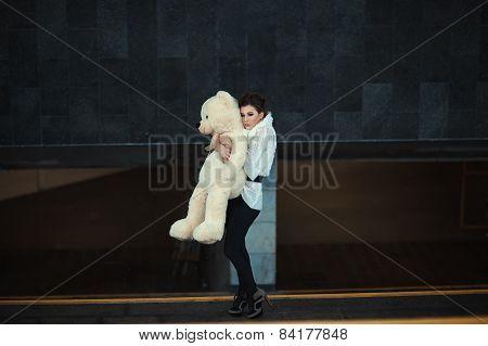 Sad Girl With A Bear.