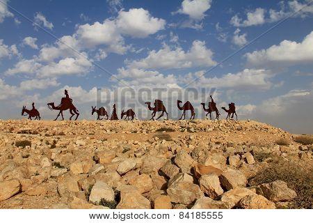 NEGEV, ISRAEL - FEBRUARY 7: Camels caravan in  desert at En Avdat National Park on February 7, 2015 in Negev, Israel poster