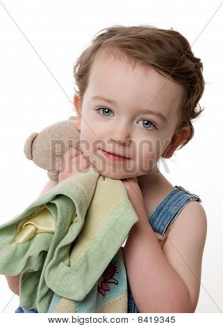 Toddler Cuddling With Blanket