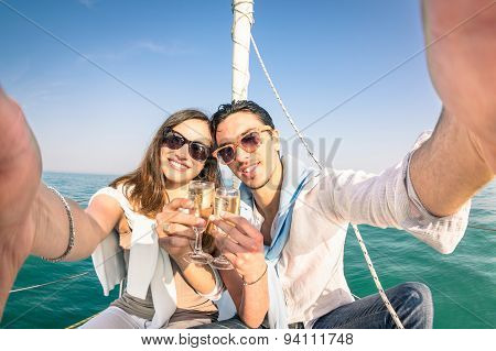 Young Love Couple Taking Selfie On Sailing Boat Cheering With Champagne Wine - Happy Jubilee Party