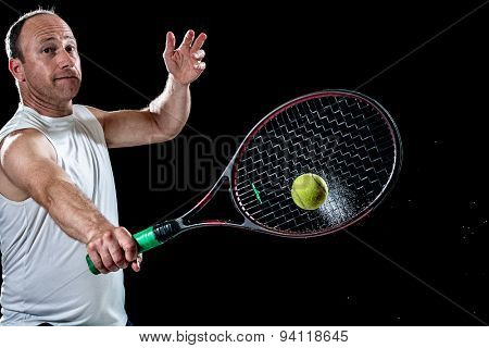 Tennis action shot. Backhand. Studio shot over black.