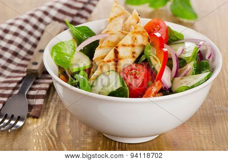 Salad With Grilled Chicken In  White Bowl.