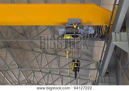 Indoor Overhead Crane On A Yellow Steel Beam