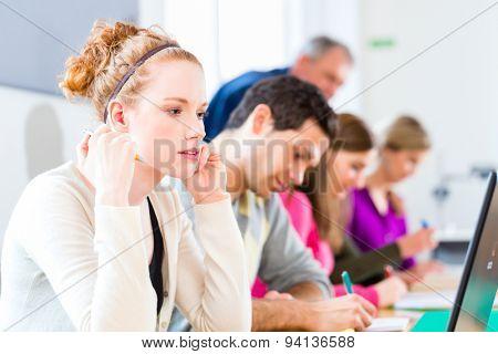 University college students having examination, the professor overseeing