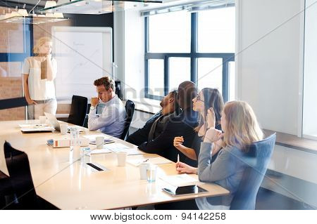 Female White Executive Leading A Meeting