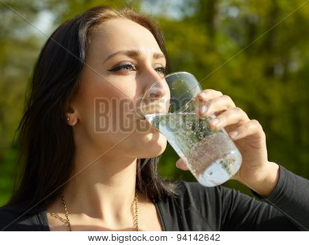 Woman With Glass Of Sparkling Water