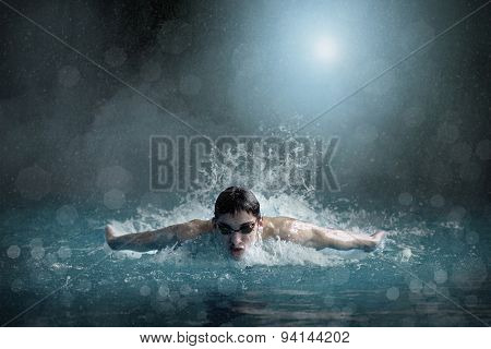 Swimmer in open waterpool, swim one of swimming style.