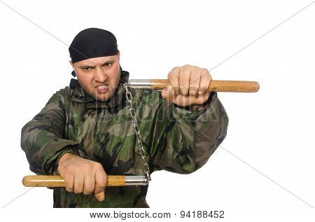 Young man in soldier uniform holding nunchaks isolated on white