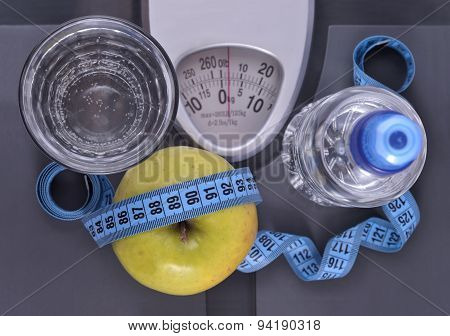 Bottle Of Water, Green Apple, Glass Of Water And Measuring Tape