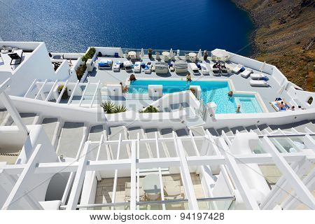 Oia, Greece - May 17: The Tourists Enjoying Their Vacation At Luxury Hotel On May 17, 2014 In Oia, G
