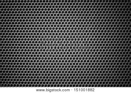 Steel grating black background With hexagonal holes