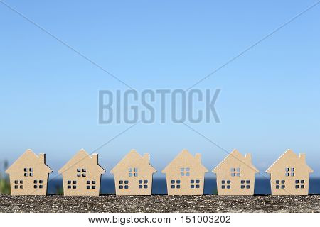 wooden toy houses with blue sea and sky background