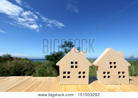 wooden toy house with clear blue sky background