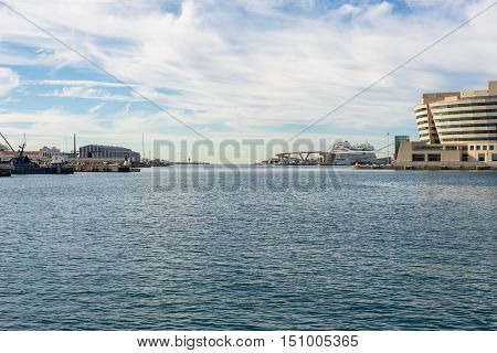 BARCELONA, SPAIN - SEPTEMBER 15.Cruise ship behind the World Trade Center Barcelona on September 15, 2016. The marina is popular and an important destination for cruise trips