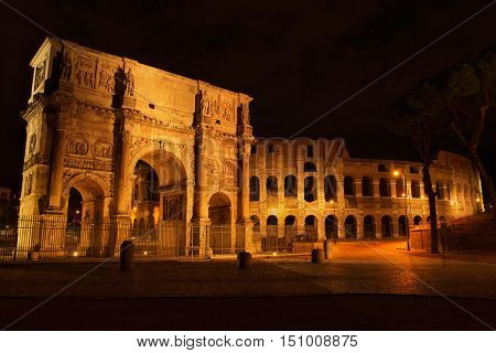Arch of Constantine and The Colosseum at the Roman Forum in Rome at night Italy