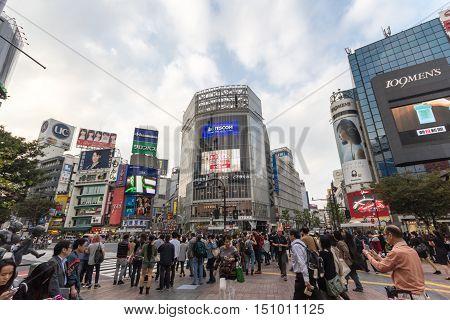 Tokyo Japan - October 22 2015 : Unidentified pedestrians cross at Shibuya Crossing one of the busiest crosswalks in Tokyo.