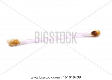 Ear wax on cotton swab isolated on white background