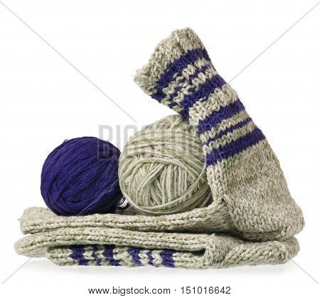 Knitted warm socks with yarn threads over white background