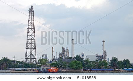 landscape of Oil distillation Tower at refinery plant along river