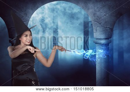 Happiness Asian Witch Woman Show His Magic From Her Stick