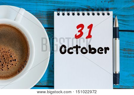 October 31st. Day 31 of month, calendar and hot coffee cup at translator or interpreter workplace background. Autumn time. Empty space for text.