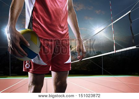 Professional volleyball player in action on the night open air court