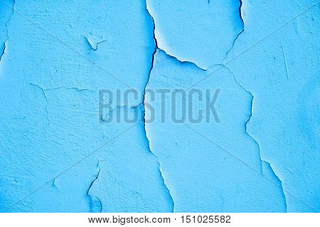 Old texture turquoise blue cracked wall, the old paint texture is chipping and cracked fall destruction. Grunge wall texture for design