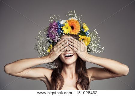 Smiling Woman With Flower Wreath On Her Head.