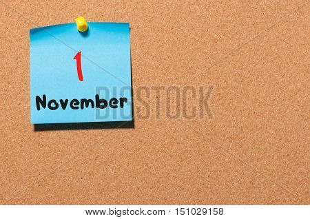 November 1st. Day 1 of month. Calendar on notice board. Autumn time. Empty space for text.