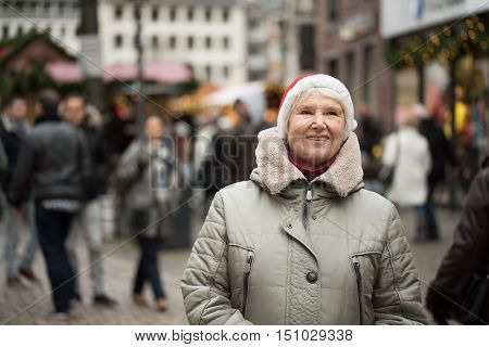 Elderly Woman At Chrismas Market
