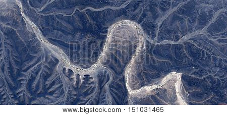 stone ghost in the desert, abstract surreal landscapes of deserts of Africa from the air, fantasy landscape eroded by water, drawings roots, dark blue background abstract naturalism of Munimara