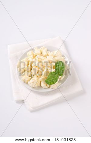plate of crumbled feta cheese on white place mat