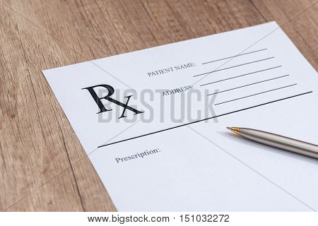 rx blank with pen on wooden desk