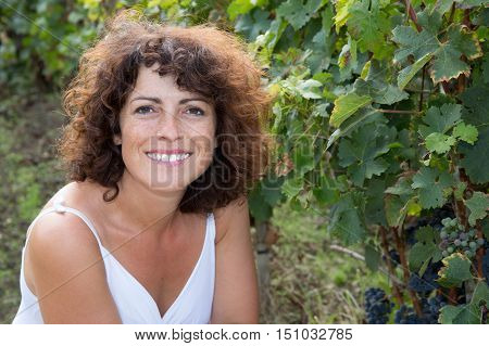 Winegrower Happy And Smiling Woman In Vine Rows