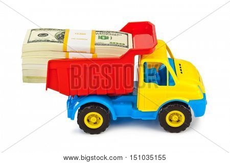 Toy car truck with money isolated on white background