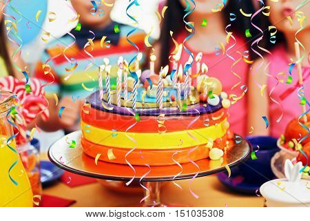 Children blowing candles on tasty cake at birthday party, closeup