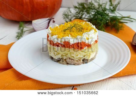 Easy Diet salad layers in the shape of a circle (tuna in oil boiled potatoes carrots eggs). Alternative Slavonic traditional dish