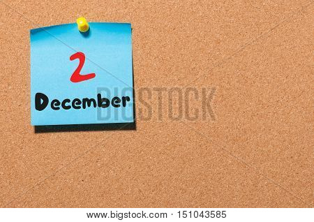 December 2nd. Day 2 of month. Calendar on notice board. Winter time. Empty space for text.
