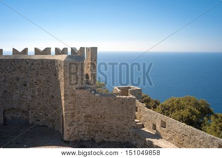 External view of the defensive walls of the Populonia Fortress (Tuscany, Italy), ancient etruscan village along the shores of the Tyrrhenian Sea (knew as Etrurian Coastline).