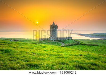 Beautiful irish castle near Atlantic ocean at sunset, Co. Clare