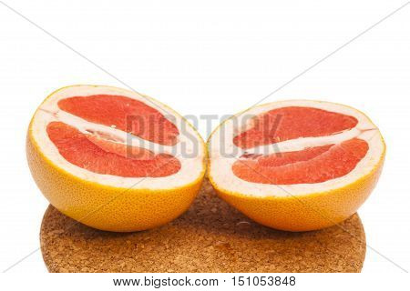 Sweet grapefruit slices on a breadboard isolated
