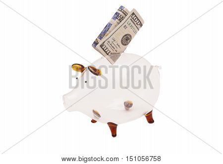 Glass piggy bank with US $100 bill