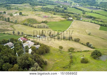 Aerial view of the hills and the cultivated fields around the medieval village of San Leo, close the border between Emilia Romagna, Marche and Tuscany. Color image.