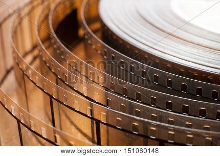 Movie film reel detail unrolled film close up on stripe with 35 mm perforation