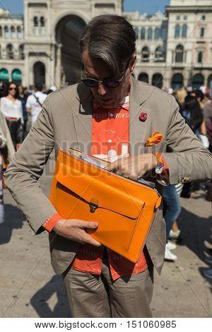 MILAN ITALY - SEPTEMBER 25 2016: Fashionable man poses outside Stella Jean fashion show building during Milan Women Fashion Week SS17.