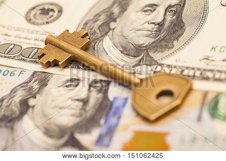 gold key on hundred dollar USA bills