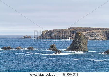 Atlantic ocean coastline with rocks and waves.