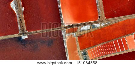 Stairway to hell, abstract photograph of the deserts of Africa from the air, abstract expressionism, red, red texture, red geometric cut by diagonal space, industrial desert roads,